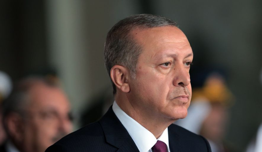 Turkish President Recep Tayyip Erdogan is attacking members of the military, teachers, lawyers, doctors, and even Supreme Court justices and prosecutors. (Associated Press/File)