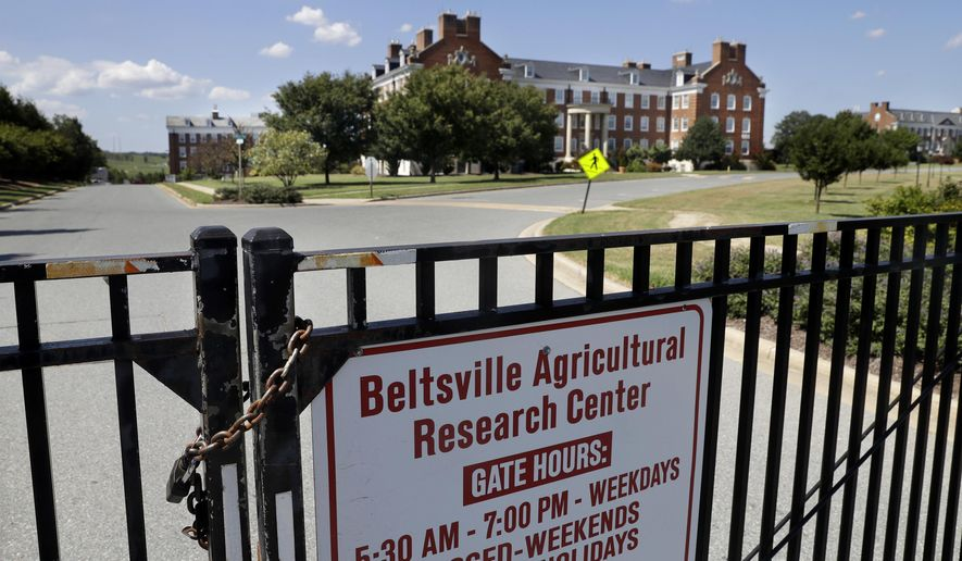 """The Beltsville Agricultural Research Center, the Agriculture Department's agricultural research center and library in seen from a locked gate after employees were informed of a threat in the morning and sent home, Tuesday, Aug. 30, 2016, in Beltsville, Md. The Agriculture Department closed offices in five states after receiving anonymous threats. USDA spokesman Matthew Herrick said the department had received """"several anonymous messages"""" that raised concerns about the safety of USDA personnel and facilities. (AP Photo/Jacquelyn Martin)"""