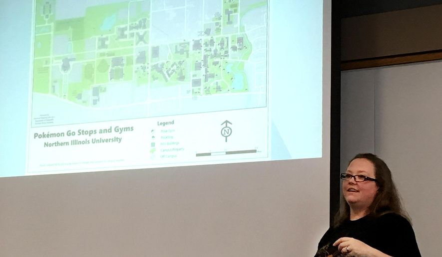 """In this Aug. 13, 2016 photo, Autumn James, a doctoral candidate in the Northern Illinois University Department of Geography, gives a presentation on how GPS data is used to create augmented reality games such as """"Pok'mon Go."""" in DeKalb, Ill. (Keith Hernandez/Daily Chronicle via AP)"""