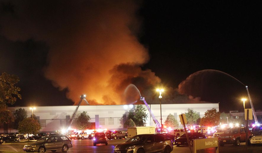 In this Monday, Aug. 29, 2016 photo, firefighters from three counties battle a large fire that ravaged the Gap Distribution Center in Fishkill, N.Y. Aug. 29, 2016. Gap spokeswoman Debbie Felix says all employees are safe. One firefighter suffered a minor leg injury. (Frank Becerra Jr./The Journal News via AP)