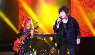 This June 17, 2013, file photo shows Nancy Wilson, left, and Ann Wilson of Heart performing on opening night of the Heartbreaker Tour at the Cruzan Amphitheater in West Palm Beach, Fla. The husband of Heart lead singer Ann Wilson has been arrested in connection with an incident involving the 16-year-old twin sons of her sister, Nancy Wilson. The Seattle Times reports that 65-year-old Dean Wetter appeared in court Monday, Aug. 29, 2016. (Photo by Jeff Daly/Invision/AP, File)