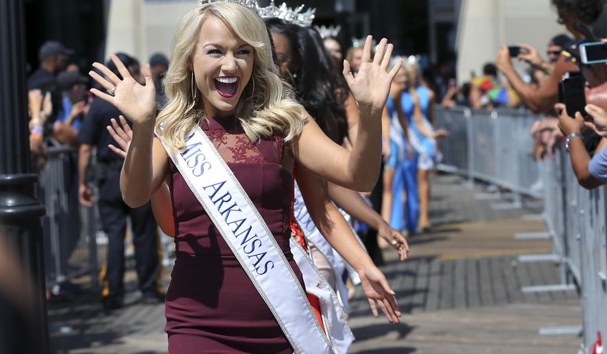 Miss Arkansas, Savvy Shields waves during Miss America Pageant arrival ceremonies Tuesday, Aug. 30, 2016, in Atlantic City. The contestants from all 50 states, the District of Columbia and Puerto Rico appeared at the traditional welcoming ceremony across from Boardwalk Hall. (AP Photo/Mel Evans) )