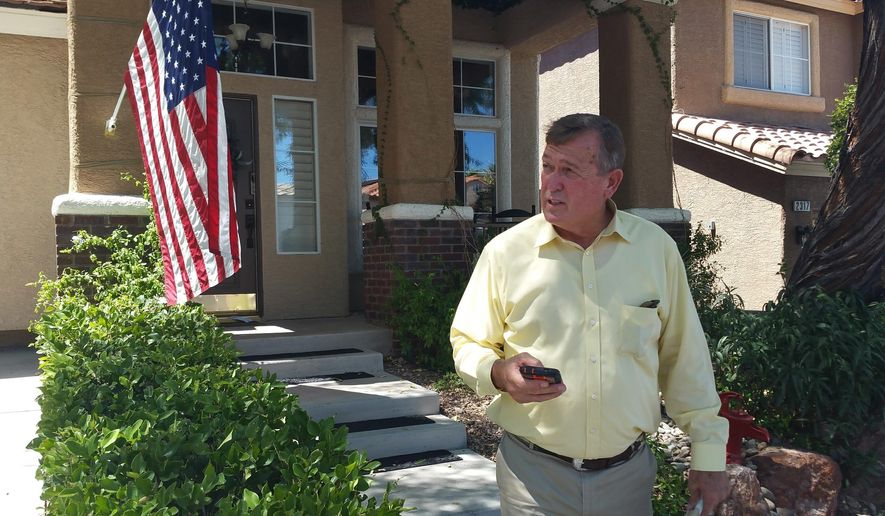 FILE - In this July 20, 2016 file photo, U.S. Rep. Cresent Hardy visits homes to talk to voters in Las Vegas. A spokesman says Hardy of Nevada is recovering after suffering a heart attack. Larry Farnsworth says the Republican underwent a routine medical procedure after the Monday night, Aug. 29, incident and remains hospitalized. (AP Photo/Michelle Rindels, File)