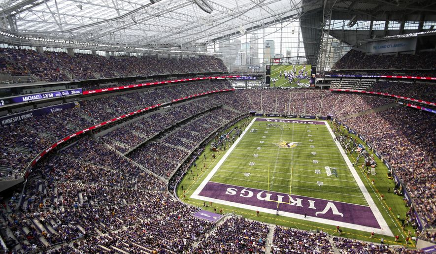 FILE - In this Aug. 28, 2016, file photo, fans watch in U.S. Bank Stadium during the second half of an NFL preseason football game between the Minnesota Vikings and the San Diego Chargers, Minneapolis. Minnesota has unveiled a gleaming new stadium. The Vikings are division champions for the first time in six years.(AP Photo/Andy Clayton-King)