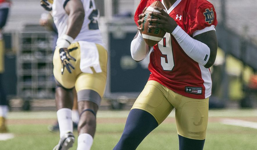 FILE - In this Aug. 6, 2016, file photo, Notre Dame quarterback Malik Zaire sets up to throw a pass during football practice at Culver Military Academy in Culver, Ind. Head coach Brian Kelly says he still doesn't know if Zaire or quarterback DeShone Kizer will take the first snap or exactly how he'll play the two when the Fighting Irish open the season at Texas on Sunday, Sept. 4. (Santiago Flores/The South Bend Tribune via AP, File)