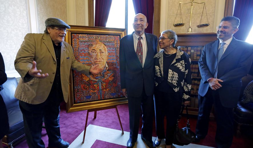 "FILE - In this May 20, 2014, file photo, artist Alfredo Arreguin, left, talks about his painting of former Washington state Supreme Court Justice Charles Z. Smith, standing in the middle with his wife, Eleanore ""Elie"" Martinez Smith, and current Justice Steven Gonzalez, right, during an unveiling ceremony for Smith's portrait at the Temple of Justice in Olympia, Wash. Smith, Washington state's first black Superior Court judge and state Supreme Court justice, died Sunday, Aug. 28, 2016, in Seattle, Wash., at 89. (AP Photo/Elaine Thompson, file)"
