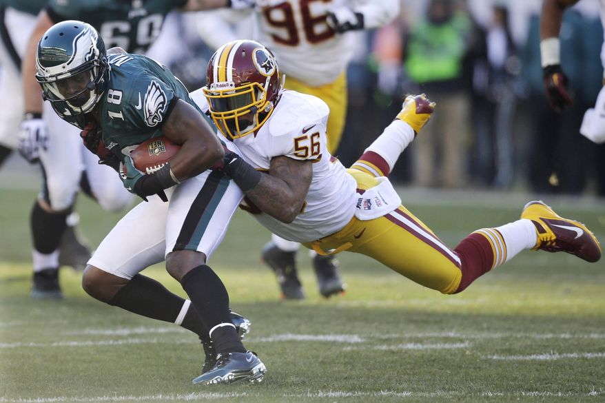 FILE - In this Sunday, Dec. 23, 2012 file photo, Philadelphia Eagles' Jeremy Maclin, left, is tackled by Washington Redskins' Perry Riley in the first half of an NFL football game in Philadelphia. The Washington Redskins released four-year starting linebacker Perry Riley and defensive lineman Stephen Paea as they continued to cut down to their 53-man roster, Tuesday, Aug. 30, 2016. (AP Photo/Mel Evans, File) **FILE**