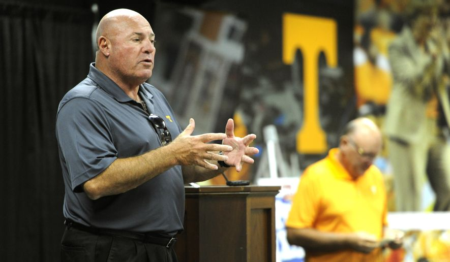 FILE - In this July 31, 2015, file photo, Tennessee defensive line coach Steve Stripling speaks during a luncheon in Knoxville, Tenn. Tennessee believes its defense has the depth that can enable the Volunteers to avoid the blown leads that haunted them in each of their losses last year.(Adam Lau/Knoxville News Sentinel via AP, File) MANDATORY CREDIT