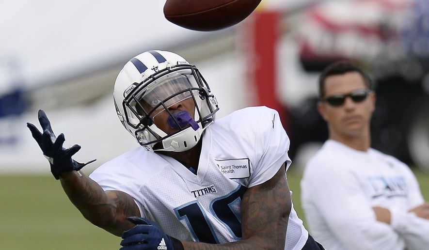 FILE - In this Aug. 4, 2016, file photo, Tennessee Titans wide receiver Tajae Sharpe (19) reaches for the ball during NFL football training camp, in Nashville, Tenn. The rookie who led the nation in receptions last season at Massachusetts is set as a starter despite not being picked until the fifth round. (AP Photo/Mark Zaleski, File)