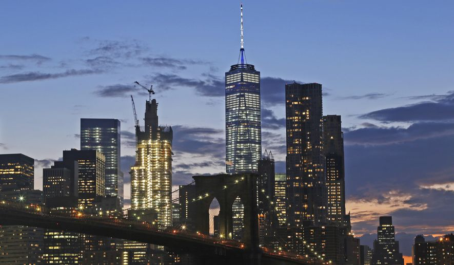 In this Aug. 19, 2016 photo, the lower Manhattan skyline, including One World Trade Center and the Brooklyn Bridge, are shown in New York. Construction cranes continue working on top of 3 World Trade Center. Fifteen years after the Sept. 11th attacks, downtown New York has been reborn, not just with the construction of One World Trade, but with a host of attractions both somber and vibrant, including the 9/11 Memorial and Museum, two retail malls, new hotels and restaurants. (AP Photo/Mark Lennihan)