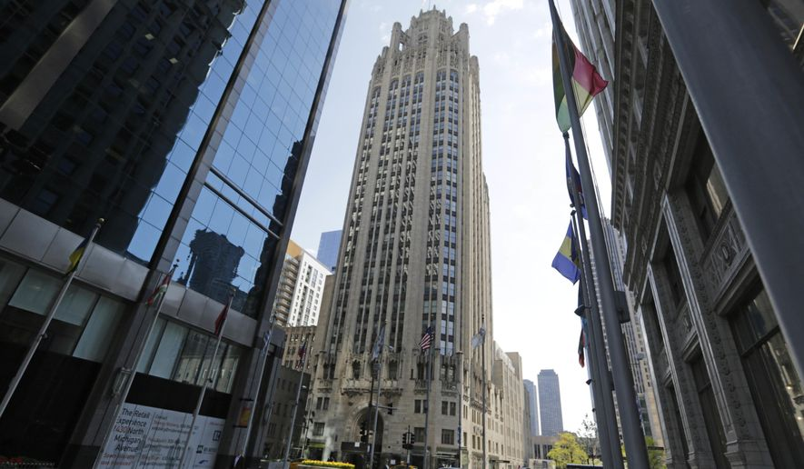 FILE - This April 25, 2016, file photo shows the Tribune Tower, center, on Michigan Avenue in Chicago. Los Angeles-based CIM Group has agreed to buy the tower for up to $240 million. Chicago-based Tribune Media announced the deal Tuesday, Aug. 30. (AP Photo/M. Spencer Green File)