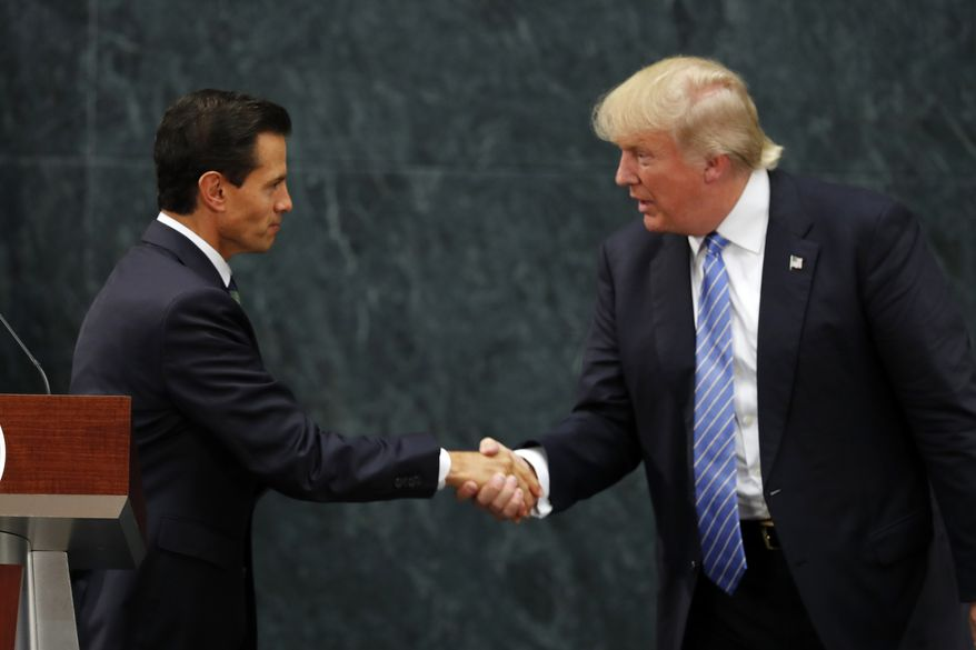 Mexico President Enrique Pena Nieto and Republican presidential nominee Donald Trump shake hands after a joint statement at Los Pinos, the presidential official residence, in Mexico City, Wednesday, Aug. 31, 2016. Trump is calling his surprise visit to Mexico City Wednesday a 'great honor.'  The Republican presidential nominee said after meeting with Pena Nieto that the pair had a substantive, direct and constructive exchange of ideas.(AP Photo/Dario Lopez-Mills)