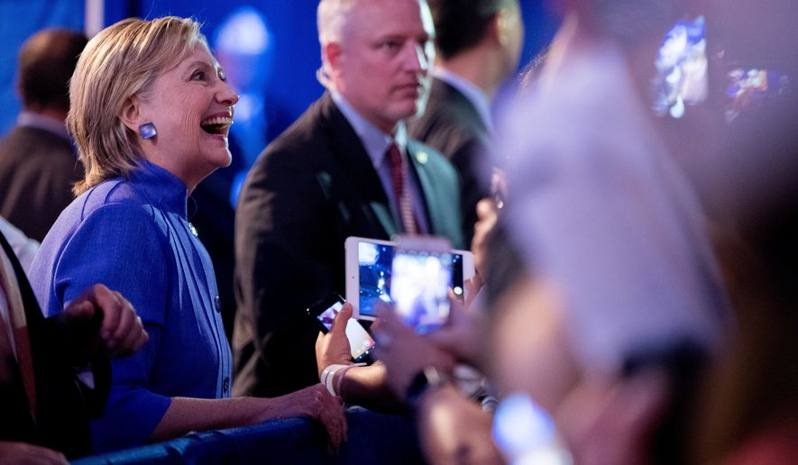 Democratic presidential candidate Hillary Clinton greets members of the audience after speaking at the American Legion's 98th Annual Convention at the Duke Energy Convention Center in Cincinnati, Ohio, Wednesday, Aug. 31, 2016. (AP Photo/Andrew Harnik)
