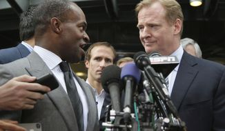 FILE - In this July 25, 2011, file photo, NFLPA Executive Director DeMaurice Smith, left, and NFL football Commissioner Roger Goodell take part in a news conference at the NFL Players Association in Washington. A few years into Roger Goodell's tenure as NFL commissioner, a grad school professor polled students on who was the most effective leader in the major sports. Goodell romped. That was before the league locked out the players in 2011. (AP Photo/Carolyn Kaster, File)