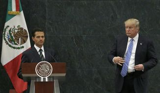 Mexico's President Enrique Pena Nieto and Republican presidential nominee Donald Trump end their joint statement at Los Pinos, the presidential official residence, in Mexico City, Wednesday, Aug. 31, 2016. Trump is calling his surprise visit to Mexico City Wednesday a 'great honor.' The Republican presidential nominee said after meeting with Pena Nieto that the pair had a substantive, direct and constructive exchange of ideas.(AP Photo/Marco Ugarte)