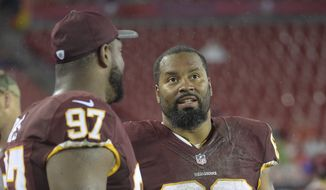 Washington Redskins Cullen Jenkins (68) talks to defensive tackle Kendall Reyes (97) during the fourth quarter of an NFL preseason football game Wednesday, Aug. 31, 2016, in Tampa, Fla. (AP Photo/Phelan M. Ebenhack)