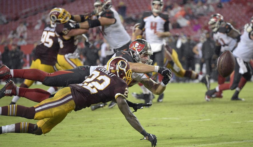 Washington Redskins cornerback Deshazor Everett (22) knocks away a pass intended for Tampa Bay Buccaneers tight end Dan Vitale (86) during the second half of an NFL preseason football game in Tampa, Fla., Wednesday, Aug. 31, 2016. The Redskins won 20-13. (AP Photo/Phelan M. Ebenhack)