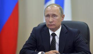 Russian President Vladimir Putin listens during a visit to Presidential Navy school at the Russian Pacific Ocean port of Vladivostok on Wednesday, Aug. 31, 2016. (Alexei Druzhinin/Sputnik, Kremlin Pool Photo via AP)