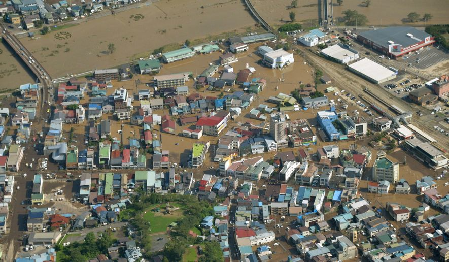 An aerial view shows a flooded area of Kuji city, Iwate prefecture, Japan, Wednesday, Aug. 31, 2016, after Typhoon Lionrock slammed into northern Japan on Tuesday evening. (Kyodo News via AP)