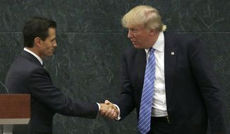 Mexico President Enrique Pena Nieto and Republican presidential nominee Donald Trump shake hands after a joint statement at Los Pinos, the presidential official residence, in Mexico City, Wednesday, Aug. 31, 2016. (AP Photo/Marco Ugarte) ** FILE **