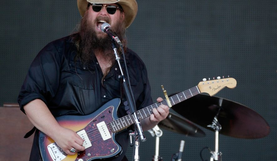 FILE - In this June 11, 2016, file photo, Chris Stapleton performs at the Bonnaroo Music and Arts Festival in Manchester, Tenn. Stapleton, Eric Church and budding newcomer Maren Morris are the leaders at the 2016 Country Music Association Awards. The three performers received five nominations each Wednesday, Aug. 31. The CMAs will air live Nov. 2 on ABC in Nashville, Tennessee, celebrating its 50th anniversary. (Photo by Wade Payne/Invision/AP, File)
