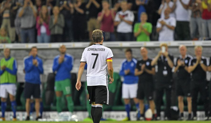 Germany's captain Bastian Schweinsteiger  leaves the pitch during a friendly soccer match between Germany and Finland in Moenchengladbach, Germany, Wednesday, Aug. 31, 2016. Schweinsteiger made his last match for the national team. (AP Photo/Martin Meissner)