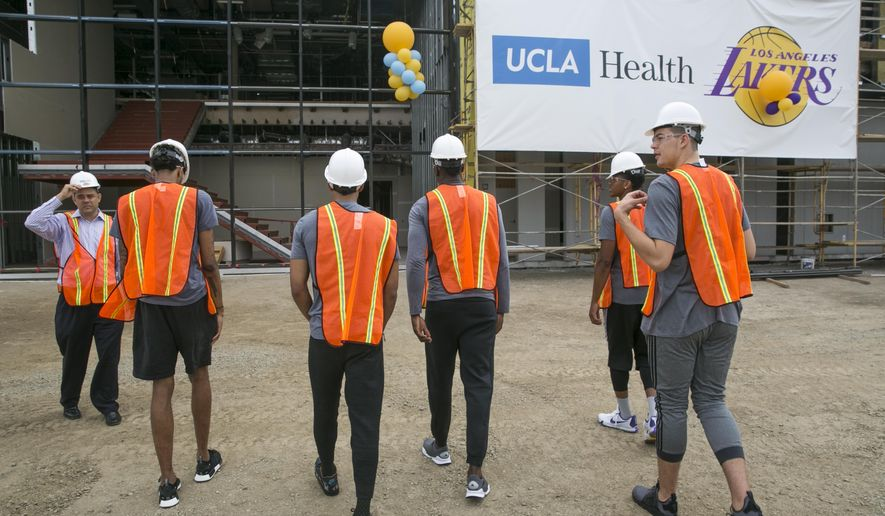 Los Angeles Lakers players tour the new Lakers state-of-the-art future home, the UCLA Health Training Center in El Segundo, Calif., on Wednesday, Aug 31, 2016. The Lakers provided an early look at their $80 million training complex Wednesday while announcing its naming rights deal with UCLA Health, the multi-hospital academic medical center. Just eight months after construction began in earnest, the Lakers are on schedule to open the UCLA Health Training Center during the 2017 offseason. (AP Photo/Damian Dovarganes)