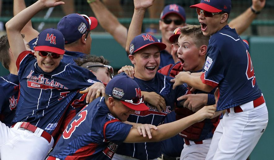 FILE- In this Aug. 28, 2016, file photo, Endwell, N.Y., pitcher Ryan Harlost, center, celebrates with teammates after getting the final out of the Little League World Series Championship baseball game against South Korea in South Williamsport, Pa. New York Gov. Andrew Cuomo announced that the Maine-Endwell Little League team will be honored with a special ceremony at the New York State Fair on Thursday, Sept. 1. The Maine-Endwell team is the first New York team to win the Little League World Series since 1964. (AP Photo/Gene J. Puskar, File)