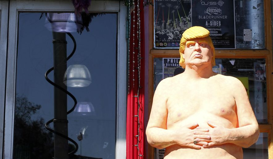 In this Aug. 18, 2016 photo, a statue of presidential hopeful Donald Trump is placed outside a shop in the Hollywood section of Los Angeles. Celebrity auction house Julien's Auctions said Wednesday, Aug. 31, that it will sell the life-sized, naked Trump statue, part of artist collective INDECLINE installed around the country earlier this month at an upcoming auction. The statue is expected to fetch at least $10,000 at the October 22 sale. A portion of the auction proceeds will benefit the National Immigration Forum.  (AP Photo/Delara Shakib)