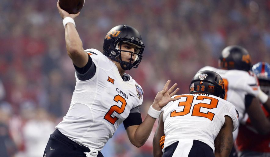 FILE - In this Jan. 1, 2016 file photo, Oklahoma State quarterback Mason Rudolph throws a pass durring the first half of the Sugar Bowl college football game in New Orleans. Rudolph heads into his junior year with a plethora of weapons around him and high expectations. The 6-foot-5 pro-style passer is coming off one of the best seasons in school history. He starts the season Saturday against Southeastern Louisiana. (AP Photo/Jonathan Bachman, File)
