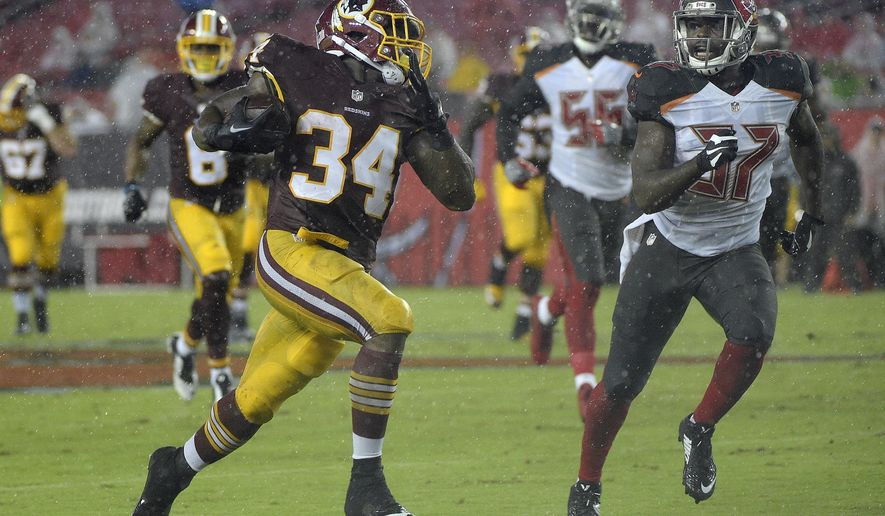 Washington Redskins running back Mack Brown (34) runs away from Tampa Bay Buccaneers strong safety Keith Tandy (37) on a 60-yard touchdown run during the second quarter of an NFL preseason football game Wednesday, Aug. 31, 2016, in Tampa, Fla. (AP Photo/Phelan M. Ebenhack)
