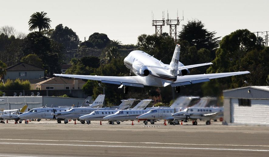 FILE - In this Jan. 21, 2011, file photo, a private jet takes off from the Santa Monica airport in Santa Monica, Calif. The Federal Aviation Administration has threatened legal action against Santa Monica over the city's ongoing efforts to shut down its airport. (AP Photo/Damian Dovarganes, File)