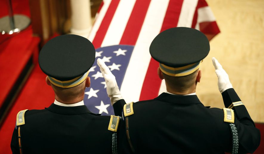 Two honor guards saluted the casket of former Army Gen. John Vessey, during his funeral at Fort Snelling Chapel, Wednesday, Aug. 31 2016, in St. Paul, Minn. Hundreds of mourners have gathered for a service honoring Vessey, a Minnesota native who became chairman of the Joint Chiefs of Staff under President Ronald Reagan. Vessey, who was 94 when he died Aug. 18., will be buried Thursday at the Minnesota Veterans Cemetery.  (Jerry Holt/Star Tribune via AP)