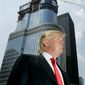 Real estate mogul Donald Trump is profiled against his 92-story Trump International Hotel & Tower during a news conference on construction progress in Chicago in a May 24, 2007, file photo. (AP Photo/Charles Rex Arbogast, File)