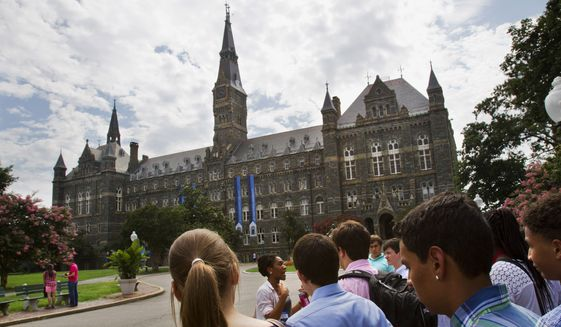 In this July 10, 2013, file photo, prospective students tour Georgetown University's campus in Washington. (AP Photo/Jacquelyn Martin, File)