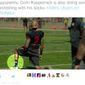 "San Francisco quarterback Colin Kaepernick practices with his team with ""pig"" cop socks. (Twitter, CBS Sports writer John Breech)"