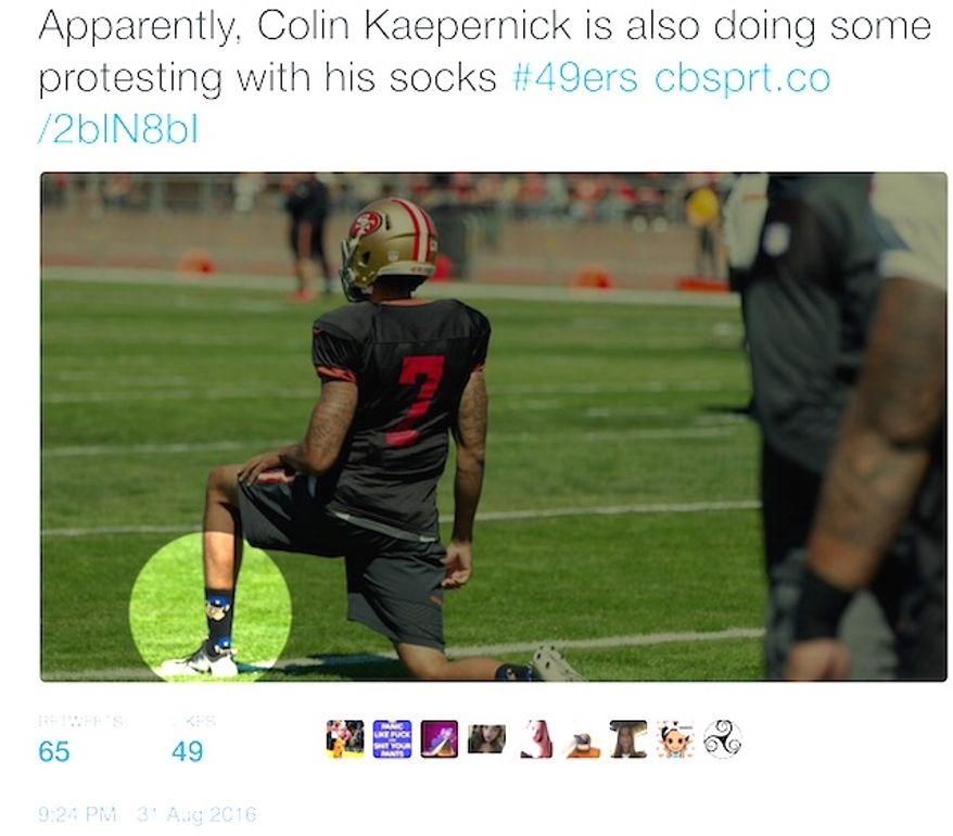 "San Francisco quarterback Colin Kaepernick practices with his team with ""pig"" cop socks. (Twitter, CBS Sports writer John Breech)"