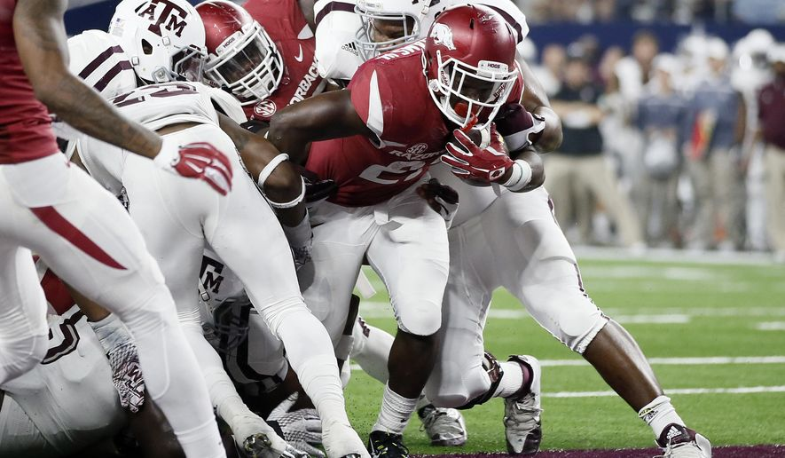 FILe - In this Sept. 26, 2015, file photo, Arkansas running back Rawleigh Williams fights his way into the end zone for a touchdown against Texas A&M during the second half of an NCAA college football game, in Arlington, Texas. The last time Arkansas running back Rawleigh Williams played a game, he was carted off the field on a stretcher after injuring his neck against Auburn last season. The Razorbacks sophomore has fully recovered from his frightening injury and will make his return to action against Louisiana Tech on Saturday. (AP Photo/Tony Gutierrez, File)
