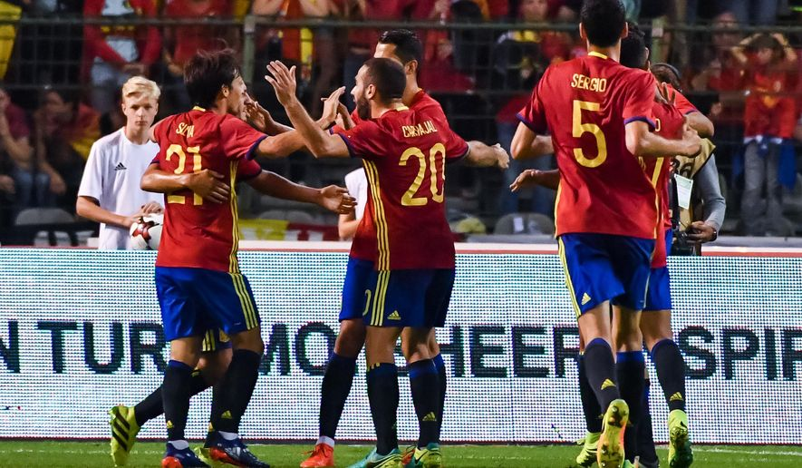 Spain's David Silva, left, celebrates with teammates after he scored against Belgium during a friendly soccer match at the King Baudouin stadium in Brussels on Thursday, Sept. 1, 2016. (AP Photo/Geert Vanden Wijngaert)