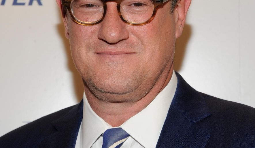 "FILE - In this April 11, 2012 file photograph taken by AP Images for The Hollywood Reporter, 'Morning Joe' host Joe Scarborough arrives at The Hollywood Reporter 35 Most Powerful People in Media event in New York. Scarborough has set his feud with Donald Trump to music. The ""Morning Joe"" host and music aficionado wrote and recorded a song, ""Amnesty Don,"" that he posted on his Facebook page. The country-rock tune attacks the Republican candidate for shifts in his position on immigration. (Evan Agostini/AP Images for The Hollywood Reporter, File)"