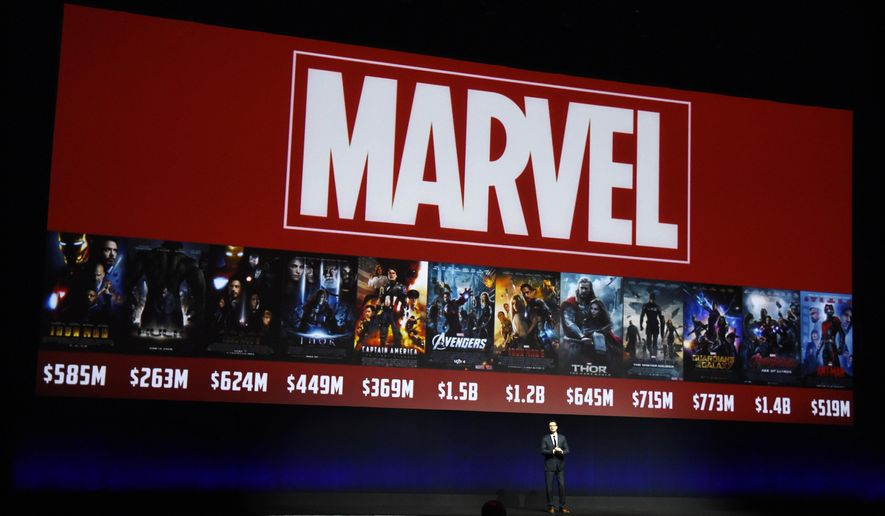 """FILE- In this April 13, 2016, file photo, Dave Hollis, executive vice president of theatrical distribution for Walt Disney Studios Motion Pictures, discusses the studio's Marvel brand of films during their presentation at CinemaCon 2016, the official convention of the National Association of Theatre Owners (NATO), at Caesars Palace in Las Vegas. Disney announced plans Thursday, Sept. 1, 2016, to shut down the """"Marvel: Avengers Alliance"""" online game series at the end of the month. (Photo by Chris Pizzello/Invision/AP, File)"""