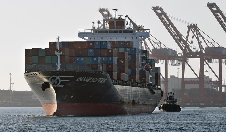 In this Wednesday, Aug. 31, 2016, photo, the container ship Hanjin Montevideo is escorted from the Hanjin Terminal in the Port of Long Beach, in Long Beach, Calif. Hanjin has filed for bankruptcy and the ship Hanjin Montevideo is to be anchored inside the breakwater. (Stephen Carr/The Daily Breeze via AP)