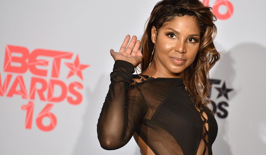 FILE - In a Sunday, June 26, 2016 file photo, Toni Braxton poses in the press room at the BET Awards at the Microsoft Theater, in Los Angeles. Grammy-winning singer raxton will be honored at the BMI R&B/Hip-Hop Awards in Atlanta, Thursday, Sept. 1, 2016.  Braxton will receive the BMI President's Award on Thursday for her musical achievements. (Photo by Jordan Strauss/Invision/AP, File)