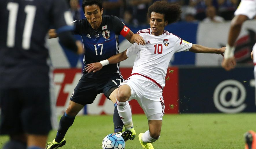 Omar Abdulrahman of the United Arab Emirates, right, and Japan's Makoto Hasebe vie for the ball during a 2018 World Cup Russia qualifier soccer match at Saitama Stadium in Saitama, north of Tokyo, Thursday, Sept. 1, 2016. (AP Photo/Shuji Kajiyama)