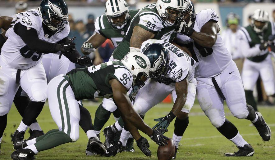 Philadelphia Eagles' Cedric O'Neal (35) and New York Jets' Josh Martin chase the ball during the second half of a preseason NFL football game, Thursday, Sept. 1, 2016, in Philadelphia. (AP Photo/Matt Rourke)