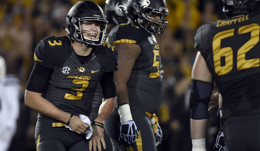 FILE - In this Nov. 5, 2015, file photo, Missouri quarterback Drew Lock left, and teammates get ready to run a play during an NCAA college football game against Mississippi State in Columbia, Mo. Though only a sophomore, Lock has more experience than the majority of the quarterbacks in the Southeastern Conference. Only four quarterbacks in the conference have made more starts than Lock, all of whom are older. (AP Photo/L.G Patterson, File)