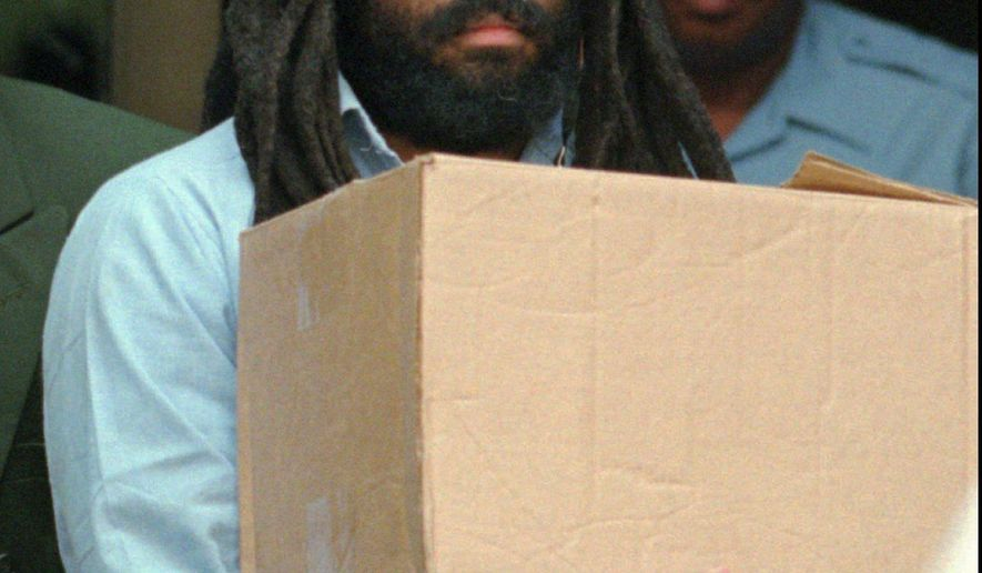 FILE - In this July 12, 1995 file photo, Mumia Abu-Jamal leaves Philadelphia's City Hall after a hearing. A federal judge in Pennsylvania has blasted a prison policy that denies former death-row inmate Abu-Jamal and others an expensive hepatitis C drug until they have advanced liver damage. Abu-Jamal is serving a life term for the 1981 killing of a Philadelphia police officer. He is a former Black Panther and radio reporter.  (AP Photo/Chris Gardner, File)