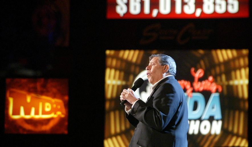 FILE - In this Monday, Sept. 4, 2006 file photo, Jerry Lewis celebrates $61,013,855 million in pledges and contributions during the Muscular Dystrophy Association Labor Day telethon in Las Vegas. In 2011, the MDA dropped Lewis as its national chairman and telethon host, then ended the telethon itself in 2015. (AP Photo/Jane Kalinowsky)