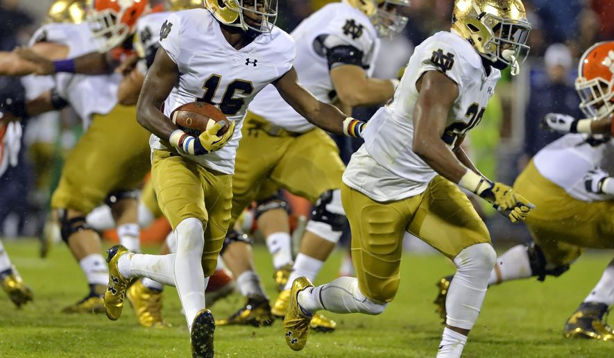 FILE - In this Oct. 3, 2015, file photo, Notre Dame's Torii Hunter Jr. (16) with blocking help from C. J. Prosise, rushes out of the backfield during the first half of an NCAA college football game against Clemson,  in Clemson, S.C. Hunter Jr. is eager to make a name for himself. (AP Photo/Richard Shiro, File)