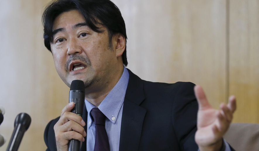 Lawyer Yoshihisa Hayakawa speaks during a press conference to announce the results of investigation into Tokyo 2020 bribery allegation, in Tokyo Thursday, Sept. 1, 2016. An independent panel commissioned by the Japanese Olympic Committee found nothing illegal in a payment made to a Singapore consulting firm in connection with Tokyo's bid to host the 2020 Summer Games. A report by the panel released Thursday said a $2.8 million Singapore dollar ($2 million) payment to the consultancy Black Tidings for bid planning services and lobbying advice was legitimate. (AP Photo/Shizuo Kambayashi)